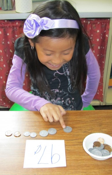 girl counting coins