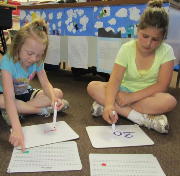 girls writing numbers