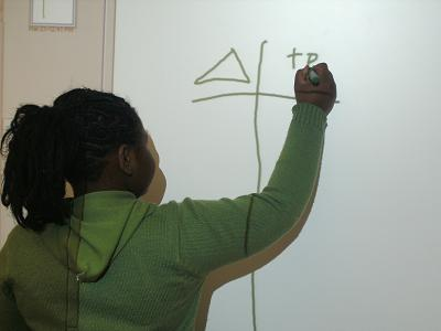 student drawing t-chart
